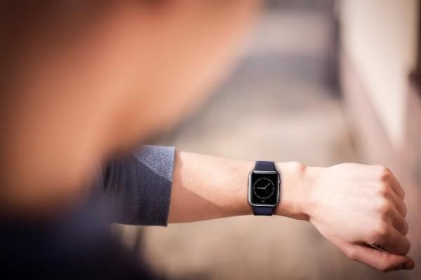 Hand wearing elegant smartwatch with clock app